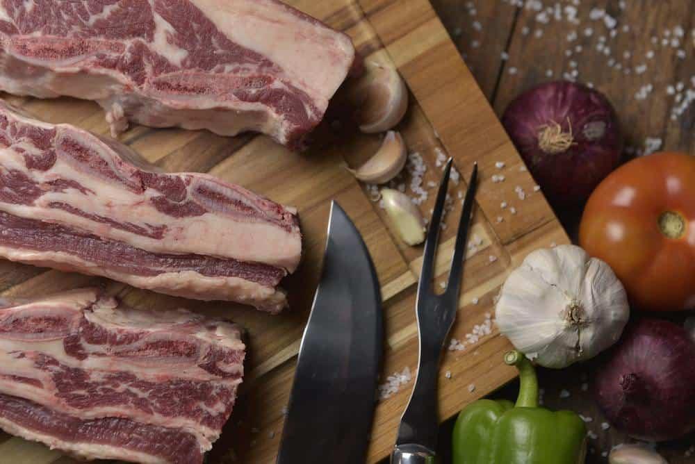 sliced raw meat chopping board