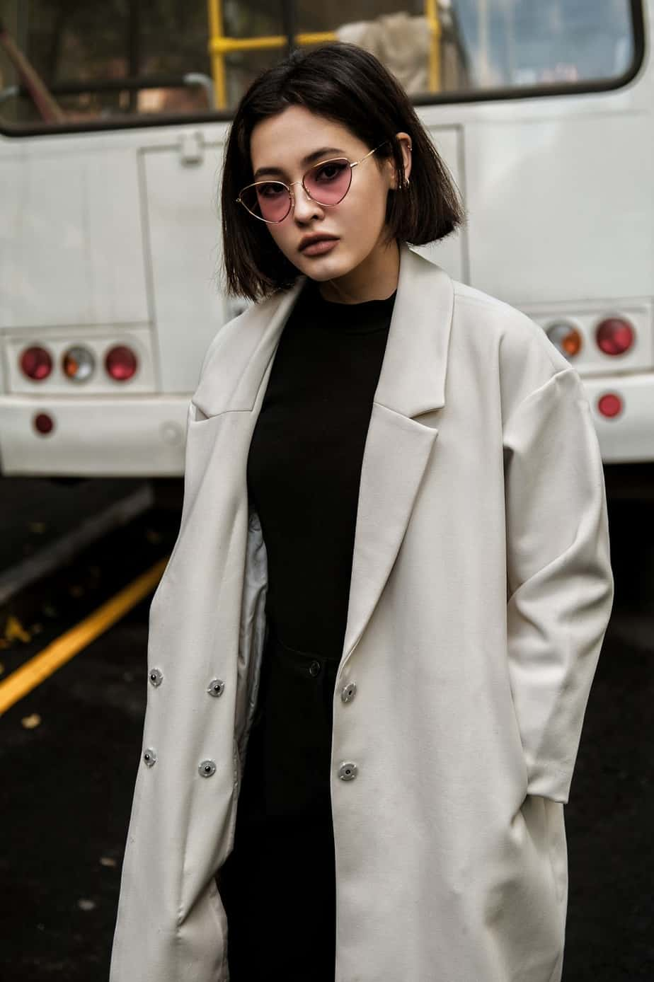 women with sunglasses and jacket