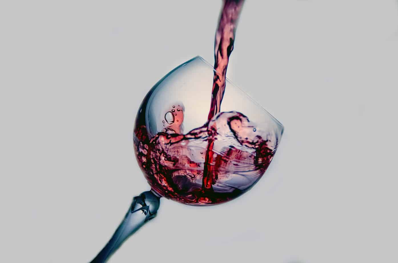 pour wine in a glass